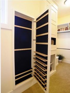 LOVE this jewelry case!  It is a full length mirror that opens up into a jewelry storage closet!  I NEED one of these :-)
