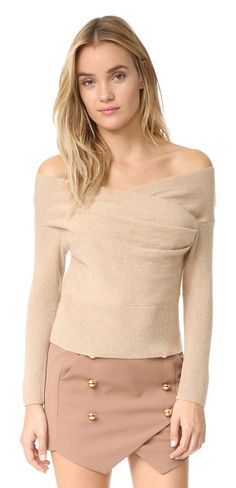Cross wrap sweater by Michelle Mason. Crossover panels lend a wrapped effect to this off shoulder Michelle Mason sweater. Ribbed sleeves and hem. Fabric: K...