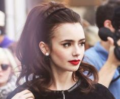 lily collins- I like this hair style... If only I could keep a dang head band on my head!
