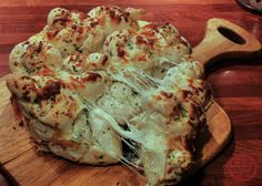 Rolls brushed with melted butter and garlic, sprinkled with cheese then baked together make these pull apart cheesy garlic knots one the best breads you can put on your table. Serve these as a sid…