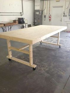 Art table on casters, some storage underneath would be a nice addition....