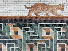 "oblivious cat, mosaic, bachor Oblivious Cat 18″ x 24″ 2013 Marble  (Price on request.)   The third and final piece of the ""Recent finds from Ostia"" series. The 3D maze pattern depicted is found in ancient Greek and Roman mosaics. However mice have gotten into this one – unbeknownst to a patrolling feline. Now that this piece in complete, the cat reminds me of one of the animals depicted on the Ishtar Gate of Babylon in Istanbul's Archaeology Museum. 'Oblivious Cat' is a relatively…"