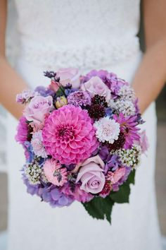 This bouquet relies on a variety of flower species that add different textural elements and an array of shades of purple that contribute to the visual interest of the arrangement.