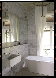 marble tiled bath.  st vincent place house by o'connor and houle architects.