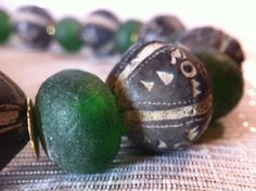 African handmade Clay Beads and Glass necklace by monuandmonu Handmade Beads, Handmade Necklaces, Gum Arabic, Black Clay, Green Powder, To Color, Short Necklace, Mortar And Pestle, Clay Pots