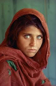 Photo of Afghan girl shot by Steve McCurry in a refuge camp in Pakistan which became a famous cover of National Geographic Magazine in June 1985. Seventeen years later, McCurry went back to find that girl and photograph her again.