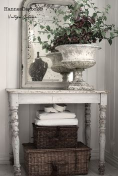 The planter, the mirror the basekts.....oh my!Shabby French Decor