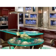 In place of upper cabinets, certified kitchen designer Elina Katsioula-Beall uses recessed, open cubbies inside a pebble-rock wall to showcase glassware, for a sleek, modern look. Glass Countertops, Kitchen Countertop Materials, Kitchen Backsplash, Backsplash Ideas, Kitchen Tops, Glass Kitchen, Bar Kitchen, Kitchen Sinks, Kitchen Gadgets