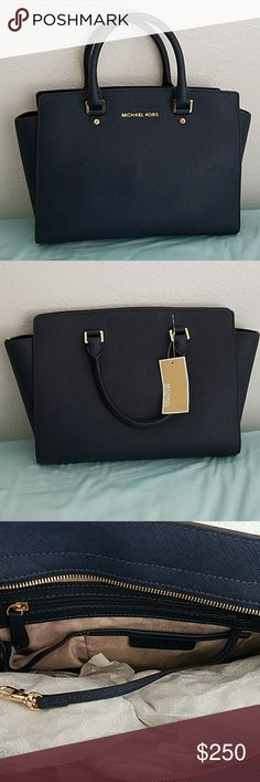 "Michael Kors Selma (Large) Never used Michael Kors Large Selma in navy saffiano leather.  Still has tag attached.  Although it is new there are some scratches on the Michael Kors lettering (pic #6), a few scratches on the feet of the bag (pic #7), and a scratch on the zipper pull (pic #8).  Comes with the dustbag, leather care card, and detachable shoulder strap.  Dimensions are approximately 13"" wide at the bottom (16"" wide at the widest point), 9 1/4"" height, and 6"" deep. Michael Kors Bags…"