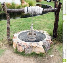 Photo about Water Well with Wooden Bucket. Image of wall, agriculture, garden - 43538243 Well Pump Cover, Wishing Well Garden, Outdoor Furniture Plans, Water Well, Water Water, Garden Deco, Bottle Garden, Exotic Plants, Outdoor Projects