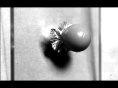 An Incredible Super Slow-Motion Video of a Ball Cracking Glass Filmed at 10 Million Frames Per Second