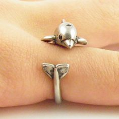 Thisdolphin ring is slightly adjustable with a gentle squeeze. It fits a size 5-9. He is sweet with Swarovski Crystal eyes, blow hole and dorsal fin as this little guy wraps around your finger.