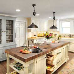 Love the beautiful timber top on this island bench,combined with the white cabinets and overhead lighting, perfection-English Country Decorating Style Design Ideas, Pictures, Remodel, and Decor - page 88