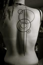 Not sure what it means, if anything, but I like this. Perhaps a smaller version on the wrist or forearm...?
