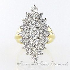 There are 33 = round brilliant cut diamonds styled in a marquise cluster white and yellow gold setting Diamond Cluster Ring, Diamond Rings, Antique Engagement Rings, Diamond Engagement Rings, Moissanite Diamonds, Dress Rings, Sparkle, Yellow, Gold