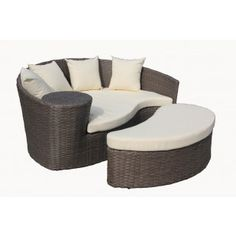 Curved Rattan Sofa & Foot Stool - Brown & Cream. Curved rattan sofa & foot stool with cushions. Ideal for gardens and conservatories.