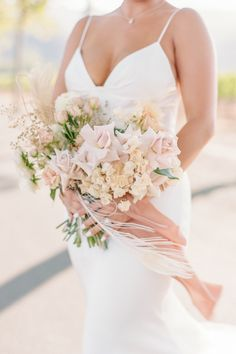 """From the editorial """"This Napa Valley Garden Elopement Is Everything We Love About Weddings"""". @amandavidmardesign created a stunning bouquet of roses, dahlias, bleached bougainvillea, bleached peacock feathers, and dried grasses. It was a heavenly day to say the least. You can see more of this epic event in the full gallery on SMP! 💕  Photography: @janinelicarephotography #stylemepretty #weddingbouquet #weddingflowers #weddingflorals #springwedding #summerwedding Wedding Reception Flowers, Spring Wedding Flowers, Wedding Flower Arrangements, Floral Wedding, Floral Arrangement, Garden Wedding, Dream Wedding, Wedding Bridesmaid Bouquets, Floral Gown"""