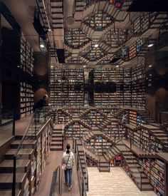 Straight out of Inception or the grand staircase from 'Hogwarts Castle' in the Harry Potter series is a whimsical, mind-tripping bookstore in China. Zhongshuge Bookstore in Chongqing city has an interior that's the stuff of … Chongqing, Escher Paintings, Famous Album Covers, Bookstore Design, Psychedelic Experience, Mundo Geek, World Of Fantasy, Grand Staircase, Stairs