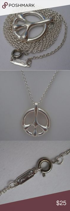 """925 Sterling Silver Peace Sign Necklace, NWOT Although stamped Tiffany & Co. (Tiffany's) it is a fabulous fake. Furthermore, I've acid tested the silver only to realize it is plated. Nonetheless, it's a cool piece and never worn. This measures 18"""" long. Jewelry Necklaces"""