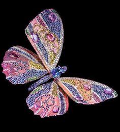 Elegant series pursuant to a 4.47 kt wind brooch, sapphire, pink corundum a 11.12 carat diamond, yellow corundum, demantoid, pink corundum.