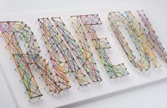 Typographic String Art...it reminds me of the old school art from back in the day.  High visual impact and very do-able.
