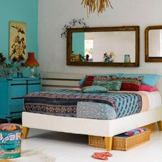 Love the bright colors on one wall and vibrant accents-and the mirrors!