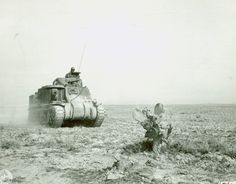 An M3 Lee tank of US 1st Armored Division advancing to support American forces during the battle at Kasserine Pass