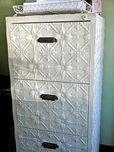 file cabinet covered with new tin and painted, need to do this to my ugly file cabinet