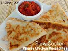 Slow Cooker Cheesy Chicken Quesadillas | Six Sisters' Stuff **added about 1 c. Monterey Jack/Colby shredded cheese to crock pot after chicken done + added about 1/2 - 1 c. salsa from fridge**