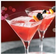 Cherry Blossom-tini (1 part cherry brandy  1 part triple sec  1/2 part grenadine    squeeze of lemon juice  Cherry and assorted berries for garnish)
