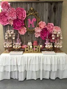 Pink and gold rustic birthday table , wood wall desert table, pink paper wall flowers , rustic chic birthday