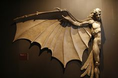 CANICULA:  Statue based on Leonardo daVinci's famous concept for artificial wings.    http://laudanumandarsenic.tumblr.com/post/11666820624/canicula-statue-based-on-leonardo-davincis