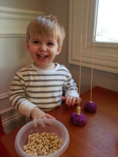 Need to keep a toddler occupied while breastfeeding a newborn? Try cereal stick towers! Fun for your toddler and keeps him occupied during those long nursing sessions!