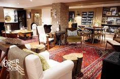 Laminate floor, rug, white trim and doors.