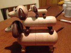 Adorable little wooden dogs that stack. So stinking cute.