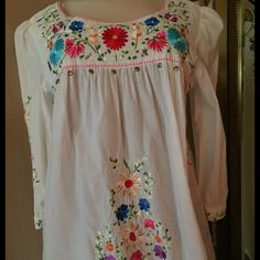 Embroidered Blouse Embroidered Peasant Blouse. Embroidery is on chest and front. As well as back, arms and underneath the arms. Hem is also finished with stitching and wrists are embroidered. Just lovely. ECI New York Tops Blouses