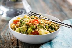 International Quinoa Salad - a low-fat, vegan salad filled with chickpeas, tomatoes, cucumbers, avocado, herbs, and FLAVOR.