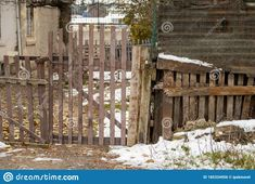 Wooden Fence Door Of A Gardenof An Abondoned Building Stock Photo - Image of ground, cottage: 185334956 Fence Doors, Wooden Fence, Winter Day, Cottage, Stock Photos, Architecture, Building, Image, Arquitetura