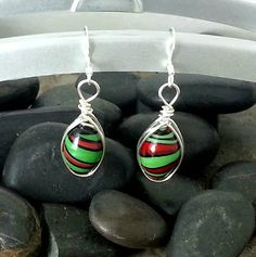 Check out this item in my Etsy shop https://www.etsy.com/listing/234450934/fun-lime-green-red-swirl-silver-drop