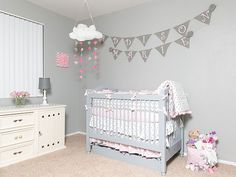 Carousel Designs's Pink and Gray Chevron Crib Bedding, which she paired with a gray Newport Cottages crib and cream dresser. To add a pop of fun, she added a pink polka-dot floor basket full of stuffed animals