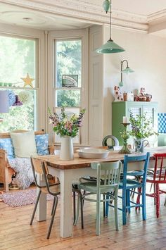 Love the different chairs! leave the table top oak to go with side board and pull color from table clothes for chairs.