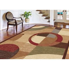 This multicolored geometric area rug will bring contemporary style into any room of your home. With bold colors and an interesting pattern, this latex-free rug is stain-resistant and allows you to update a room without changing the furniture.