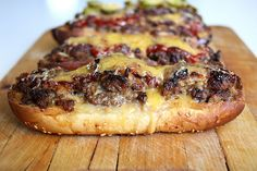 """long boy 'burgers'"" Seasoned ground beef baked in a sub roll with melty cheese."