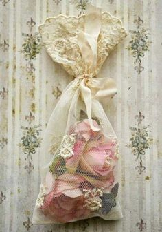 Shabby Chic...Here is a lovely way to make your own mildly scented Rose potpourri and a great way to display it as well.