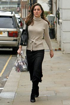 January 13th, 2007 - Kate was spotted out in London doing a bit of shopping. She paired an oatmeal colored belted sweater with a mid length black skirt.