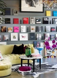 book/art wall inspiration - I know this looks cluttered, but I absolutely love the idea behind it.