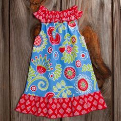 Lolly Wolly Doodle - This is a dress that is sold by Lolly Wolly Doodle. You could easily make it--just take a peasant style top, make it sleeveless, and add shirred tube around the neckline :)