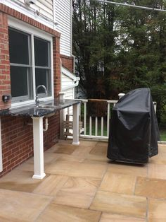 And the contractor convinced us to add an outdoor kitchen too. This is my husband's space and he loves it.