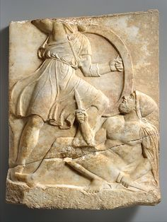 Greek. Fragment of a marble grave stele of a warrior. Unknown Greek Artist. 390 B.C. Located in the Metropolitan Museum of Art. Made of Marble