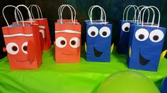 Finding Dory gift bags made with orange and blue paper bags, card stock and Sharpie. Make sure to give Nemo two different sized fins!